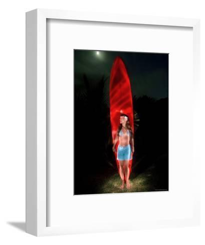 Woman Stands by a Big Wave Surf Board under a Full Moon, Hawaii-Bill Hatcher-Framed Art Print