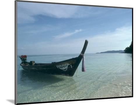 Wooden Boat Named Paradise is Tethered to a Palm Tree-Kate Thompson-Mounted Photographic Print