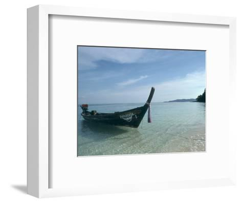 Wooden Boat Named Paradise is Tethered to a Palm Tree-Kate Thompson-Framed Art Print