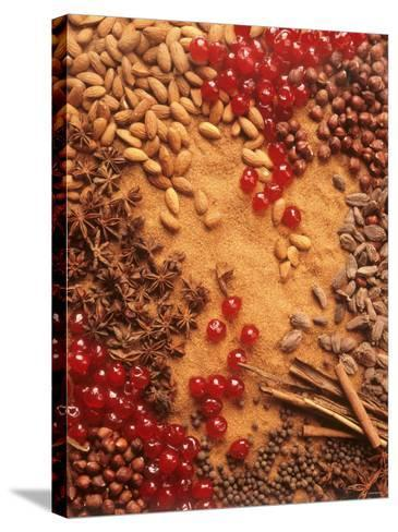 Spices, Nuts, Almonds and Cherries Forming a Surface-Luzia Ellert-Stretched Canvas Print