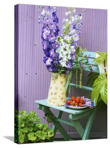 Garden Chair with Delphiniums and Plate of Strawberries-Linda Burgess-Stretched Canvas Print