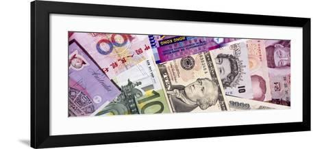 Close-Up of Assorted Currencies of Different Countries--Framed Art Print