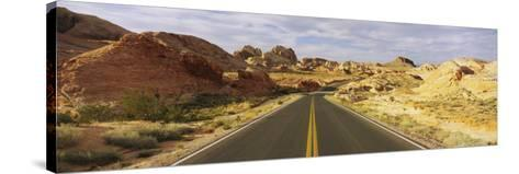 Empty Road Running Through a Landscape, Valley of Fire State Park, Nevada, USA--Stretched Canvas Print