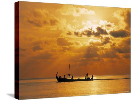 Boat at Sunset, Maldives, Indian Ocean-Jon Arnold-Stretched Canvas Print