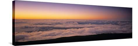 View over Clouds at Dawn-Walter Bibikow-Stretched Canvas Print