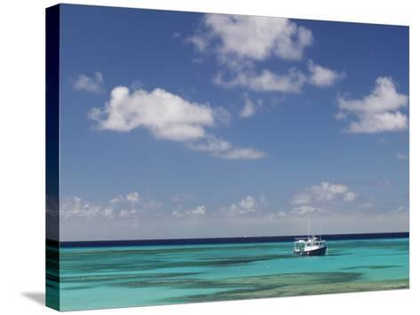 Turquoise Water and Dive Boat, Cockburn Town, Grand Turk Island, Turks and Caicos-Walter Bibikow-Stretched Canvas Print