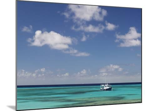 Turquoise Water and Dive Boat, Cockburn Town, Grand Turk Island, Turks and Caicos-Walter Bibikow-Mounted Photographic Print