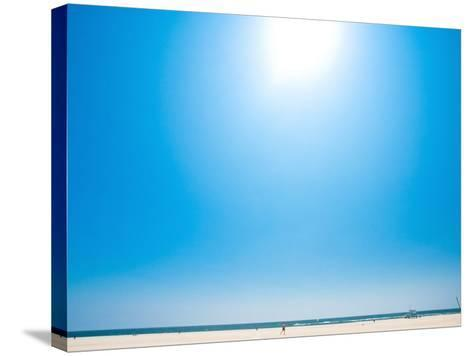 Bright Blue Sky with Sun Shining over a Beach--Stretched Canvas Print