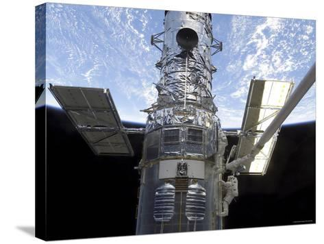 Astronauts Participate in Extravehicular Activity on the Hubble Space Telescope-Stocktrek Images-Stretched Canvas Print