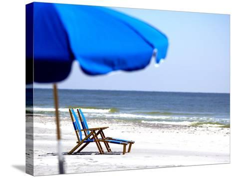 Beach Chairs and Umbrella, Ship Island, Gulf Islands National Seashore, Mississippi-Franklin Viola-Stretched Canvas Print