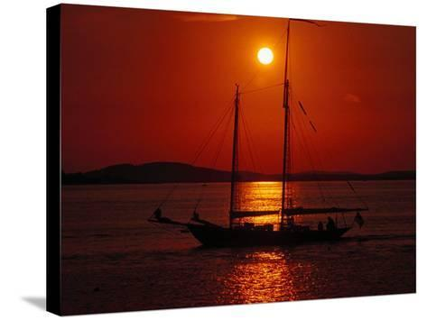 Silhouetted Sailboat, Rockport, Maine-Russell Burden-Stretched Canvas Print