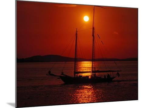 Silhouetted Sailboat, Rockport, Maine-Russell Burden-Mounted Photographic Print