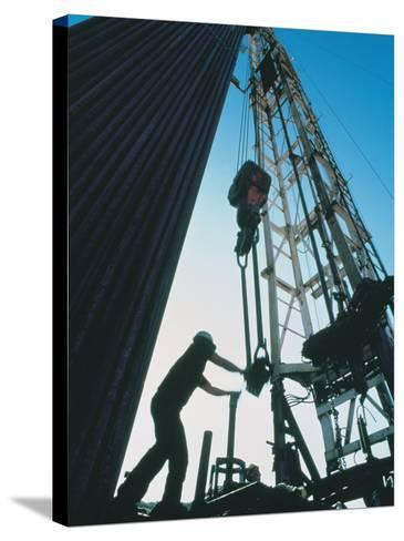 Roughneck Working on Oil Rig-Stephen Collector-Stretched Canvas Print