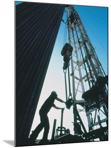 Roughneck Working on Oil Rig-Stephen Collector-Mounted Photographic Print