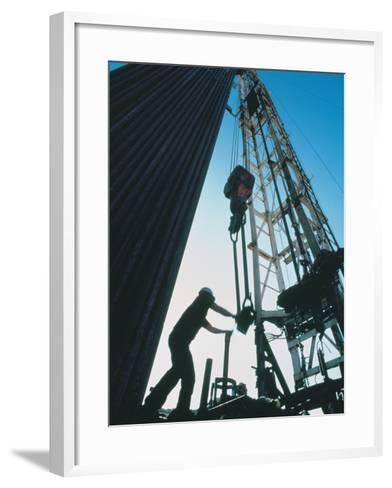Roughneck Working on Oil Rig-Stephen Collector-Framed Art Print