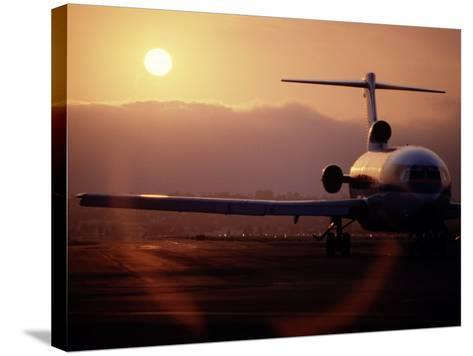 Silhouette of Airplane-David Harrison-Stretched Canvas Print