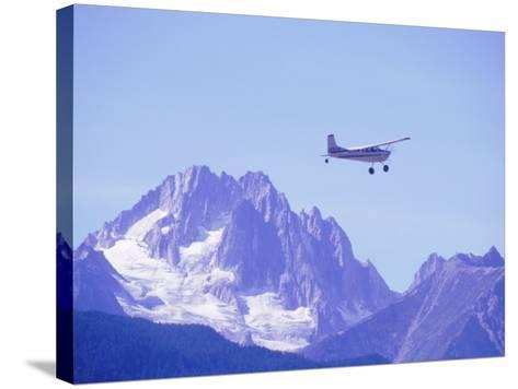 Aircraft in Flight Over Mountain, Haines, Alaska-Roger Holden-Stretched Canvas Print