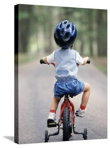 Little Boy Riding His Bicycle with Helmet-David Davis-Stretched Canvas Print