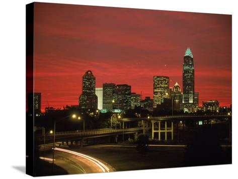 Skyline & Highway at Night, Charlotte, NC-Jim McGuire-Stretched Canvas Print