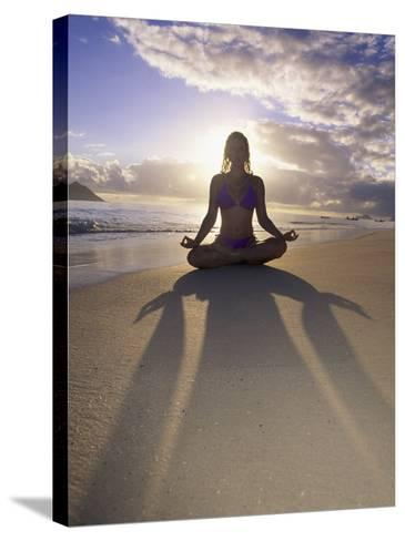 Woman Meditating on Beach-Tomas del Amo-Stretched Canvas Print