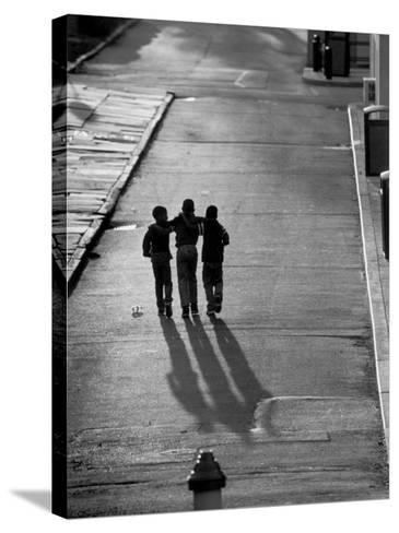 Three Boys Walking Down Street Arm in Arm-Len Rubenstein-Stretched Canvas Print