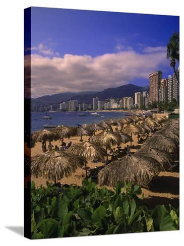 Beachfront on Playa Icacos, Acapulco, Mexico-Walter Bibikow-Stretched Canvas Print