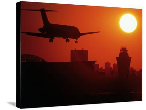 Airplane Descending at Dawn-Charles Blecker-Stretched Canvas Print