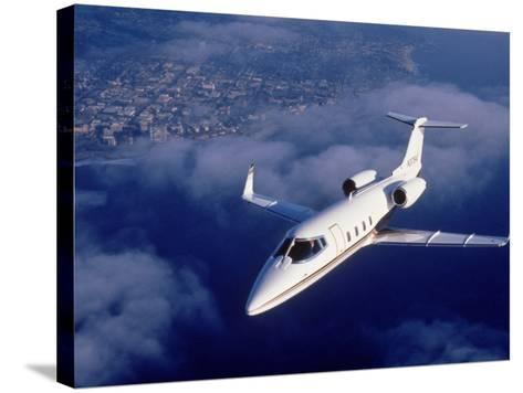 Lear Jet in Flight-Garry Adams-Stretched Canvas Print