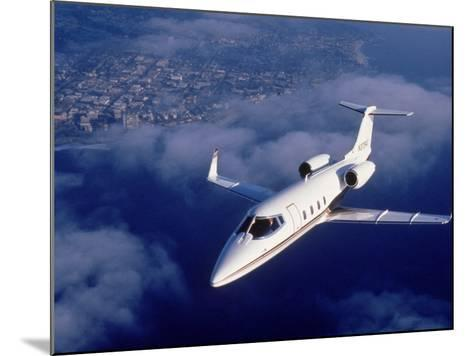 Lear Jet in Flight-Garry Adams-Mounted Photographic Print