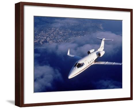 Lear Jet in Flight-Garry Adams-Framed Art Print