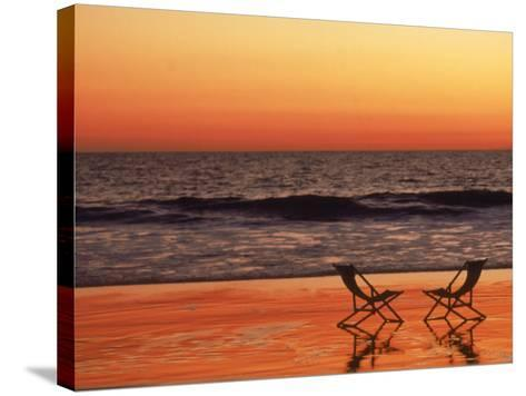Silhouette of Two Chairs on the Beach-Mitch Diamond-Stretched Canvas Print