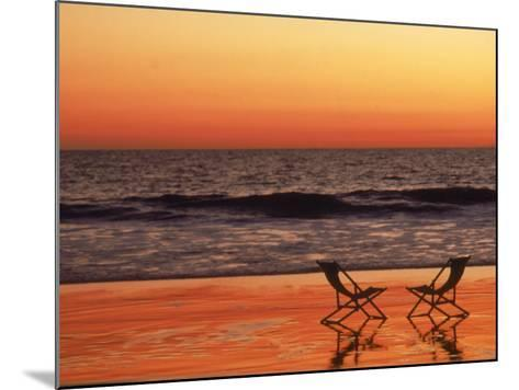 Silhouette of Two Chairs on the Beach-Mitch Diamond-Mounted Photographic Print