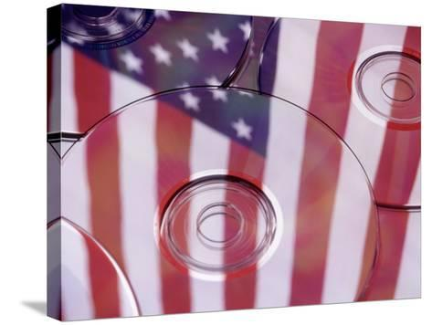 Cds with Reflection of American Flag-Jim Corwin-Stretched Canvas Print