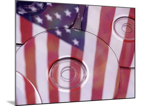 Cds with Reflection of American Flag-Jim Corwin-Mounted Photographic Print