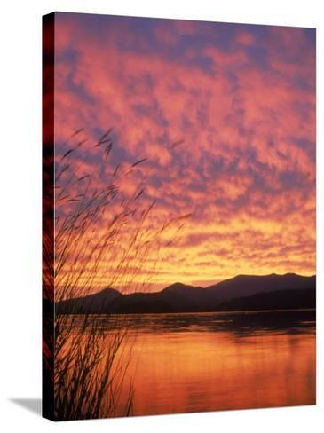 Sandpoint, Id, Sunset on Lake-Mark Gibson-Stretched Canvas Print