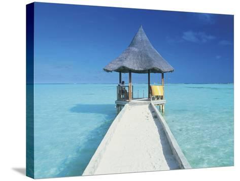 Maldives, Pier and Ocean-Peter Adams-Stretched Canvas Print