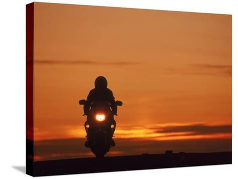 Silhouetted Motorcyclist at Sunset, Marin City, CA-Robert Houser-Stretched Canvas Print