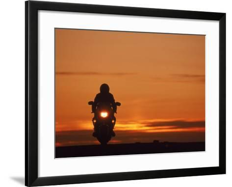 Silhouetted Motorcyclist at Sunset, Marin City, CA-Robert Houser-Framed Art Print