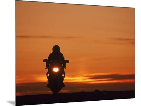 Silhouetted Motorcyclist at Sunset, Marin City, CA-Robert Houser-Mounted Photographic Print