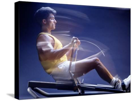 Man on Rowing Machine-Daniel Fort-Stretched Canvas Print