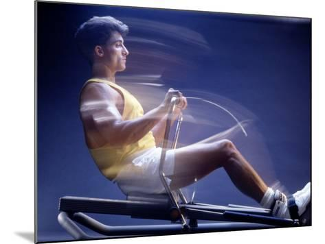 Man on Rowing Machine-Daniel Fort-Mounted Photographic Print
