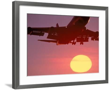 Airplane in Flight During Sunrise, Sunset-Mitch Diamond-Framed Art Print