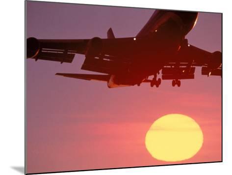 Airplane in Flight During Sunrise, Sunset-Mitch Diamond-Mounted Photographic Print