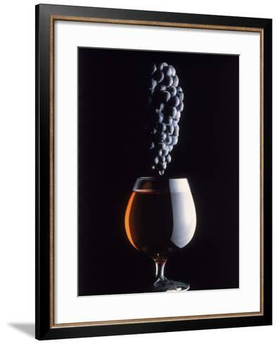 Bunch of Grapes Over a Glass of Wine-Howard Sokol-Framed Art Print