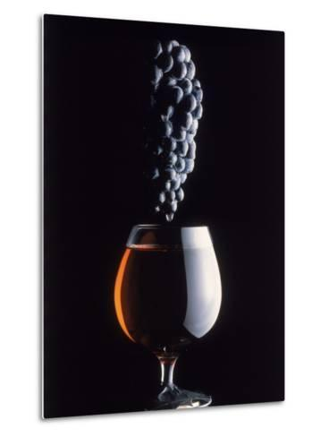 Bunch of Grapes Over a Glass of Wine-Howard Sokol-Metal Print