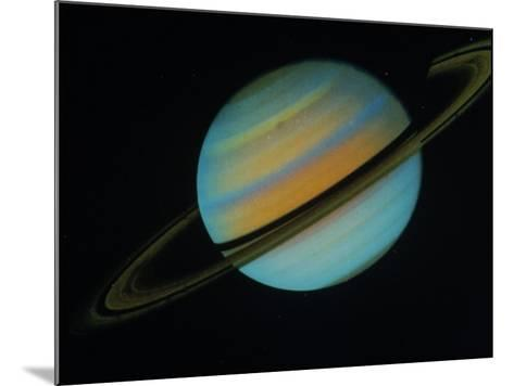 Saturn, Sixth Planet from the Sun-David Bases-Mounted Photographic Print