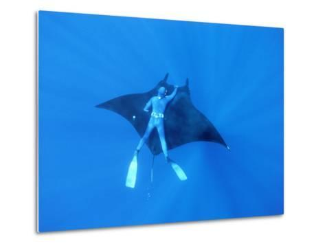 Diver Holds on to Giant Manta Ray, Mexico-Jeffrey Rotman-Metal Print