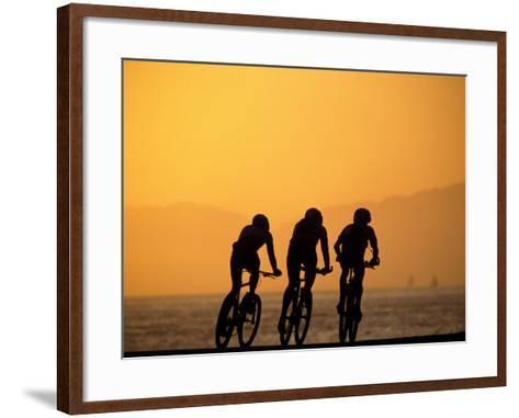 Silhouette of Three Men Riding on the Beach-Mitch Diamond-Framed Art Print