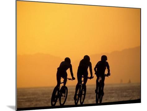 Silhouette of Three Men Riding on the Beach-Mitch Diamond-Mounted Photographic Print