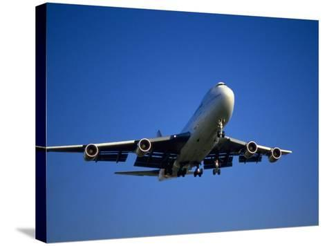 Commercial Airplane in Flight-Mitch Diamond-Stretched Canvas Print